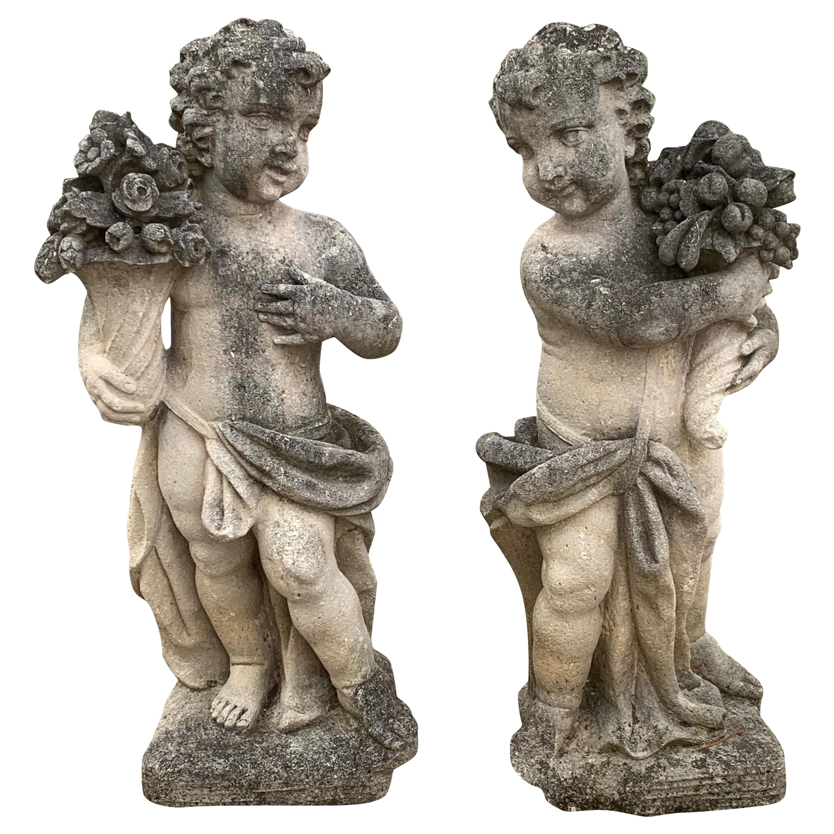 Pair of Late 19th Century Cast Stone Garden Statues of Putti