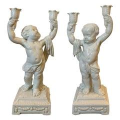 Pair of Late 19th Century Italian Creamware Putti Two-Arm Candelabras