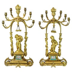 Pair of Late 19th Century Six-Light Gilt Bronze Figural Candelabras