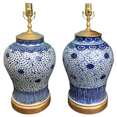 Pair of Late 19th-Early 20th Century Blue & White Vases as Lamps, Giltwood Bases
