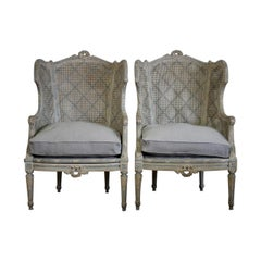 Pair of Late 19th-Early 20th Century French Painted Caned Bergeres