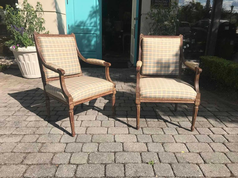 Pair of late 19th-early 20th century Louis XVI armchairs. Measures: Seat height 17.5