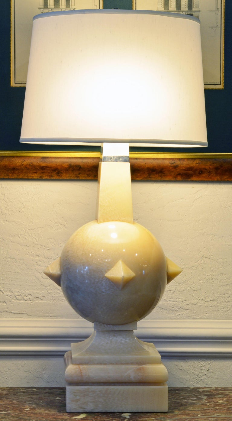 Likely of Mexican origin these impressive lamps combine a modern design with archetype elements, the sphere, the pyramids and the obelisk. Carved in a cream colored almost translucent marble and fitted with a chrome top they make a powerful artistic
