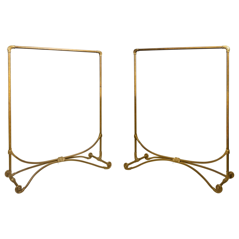 A Pair of Late Art Nouveau Brass Clothes Racks, circa 1920