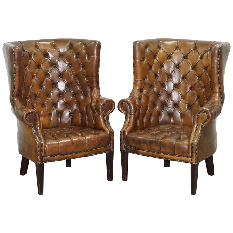 Pair of Late Victorian Chesterfield Porters Wingback Armchairs Brown Leather For Sale