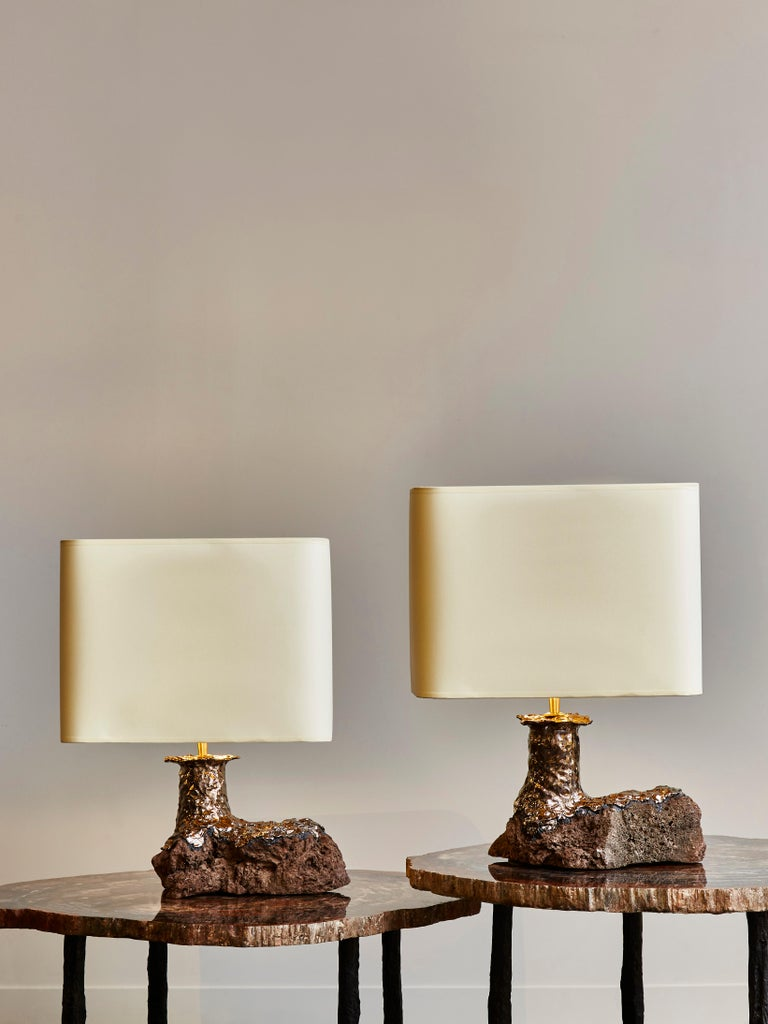 Pair of table lamps by the artist Leo Nataf, made of carved lava stone covered with glazed ceramic.