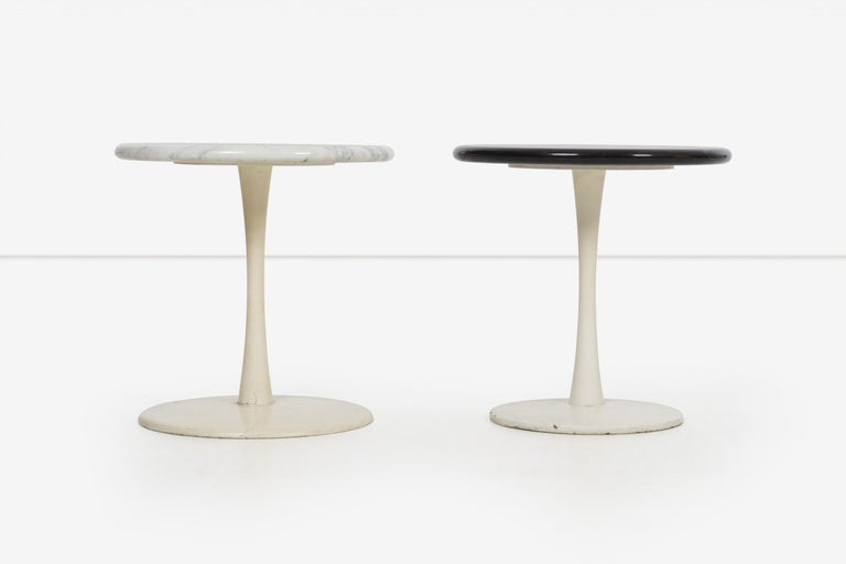 Pair of Laverne Stem tables for Laverne International, models ST-12 and ST-2 weighted cast iron bases matte white finish with solid black and white 3/4