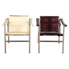 Pair of LC1 Basculant Armchairs