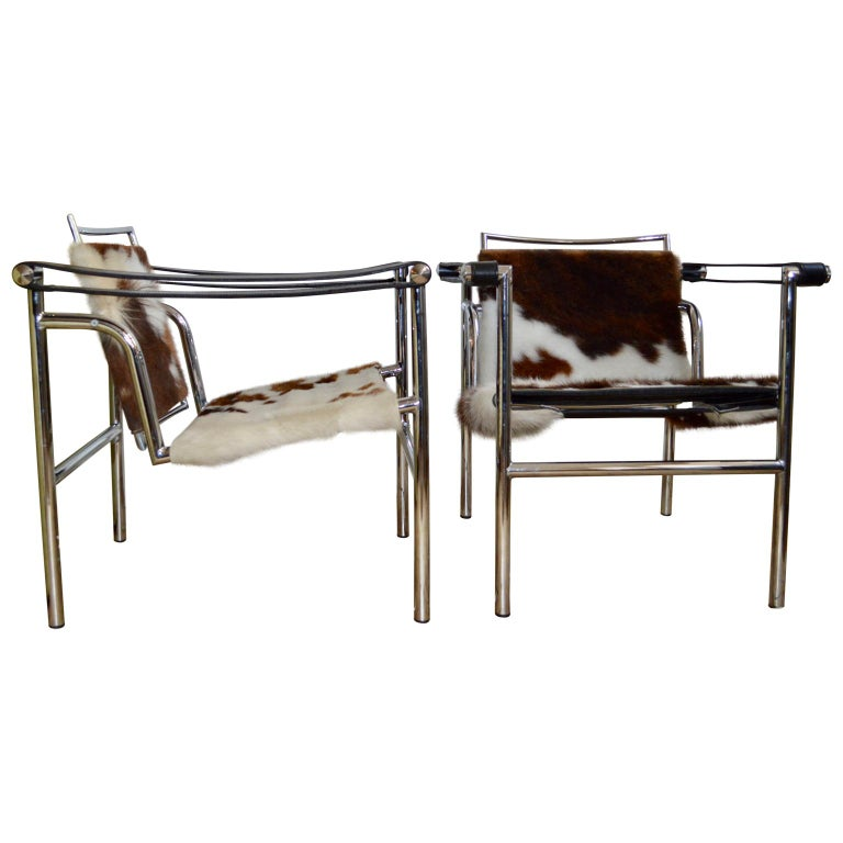 Pair of LC1 sling chairs in Pony skin.