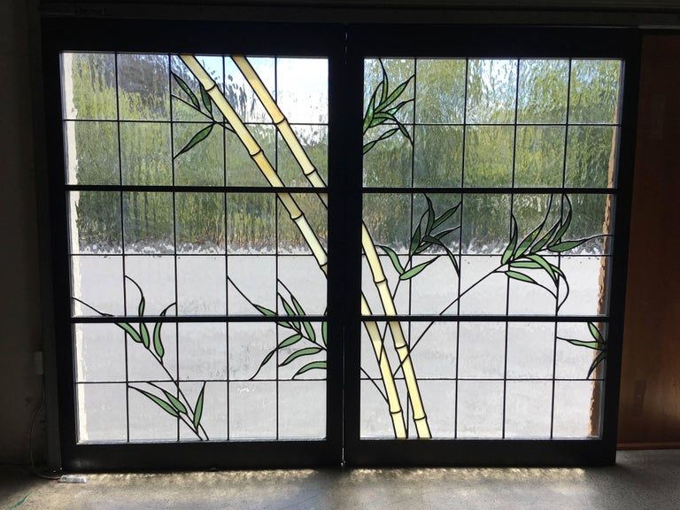 Pair of stained glass windows in a bamboo motif each one measures 36.25 wide.