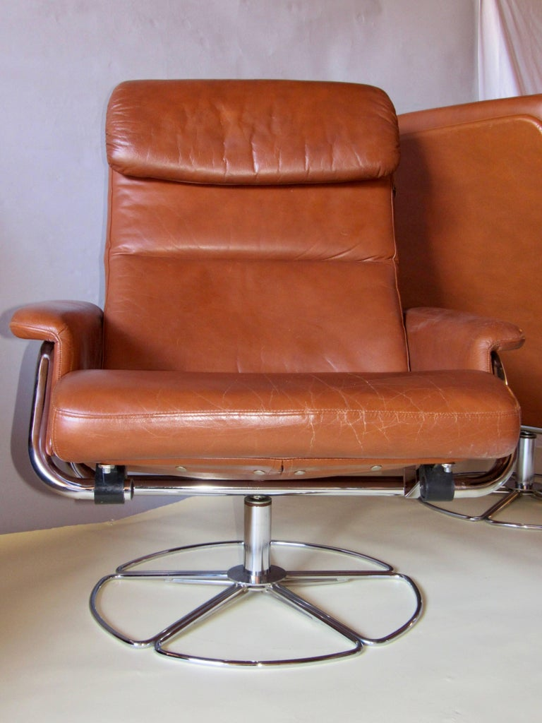 Swedish Bruno Mathsson Pair of DUX  Chrome Swivel Lounge Chairs and Ottomans 1970s For Sale