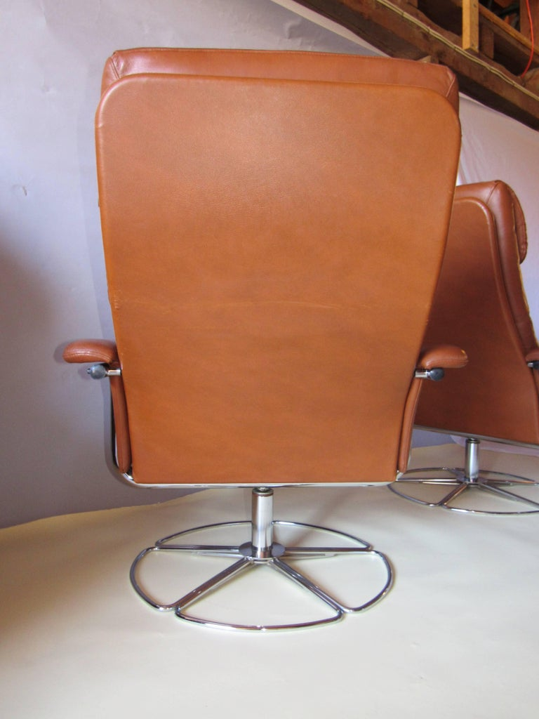 Leather Bruno Mathsson Pair of DUX  Chrome Swivel Lounge Chairs and Ottomans 1970s For Sale