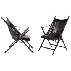 Pair of Leather and Ebonized Pear Wood Folding Chairs by Maison Jansen