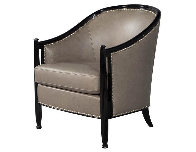 Pair of leather Art Deco parlor armchairs with black lacquer finish. These Carrocel custom made Art Deco style chairs, sleek design with period styling and proportions, finished in a hand rubbed high gloss black lacquer accented with nickel head to