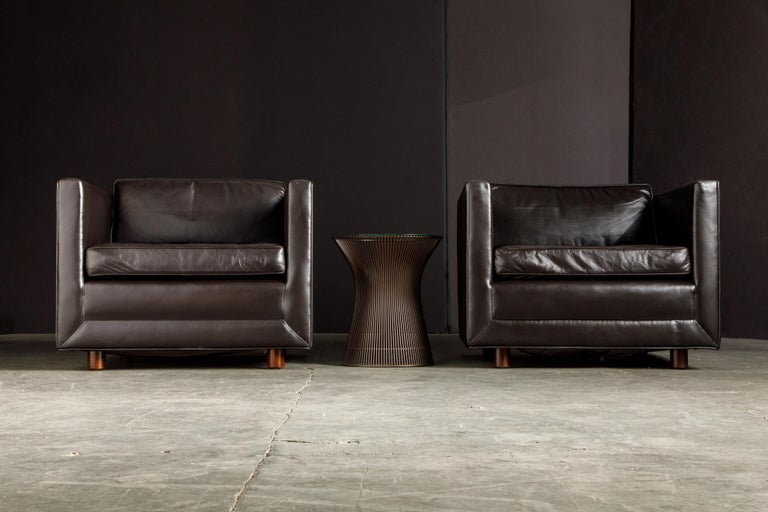 This soft and supple pair of classy leather club chairs are by Ward Bennett for Brickel, signed by Brickel Associates labels and dated 1983.   The gorgeous leather color is a deep and dark brown color that looks black in lower light settings. Per