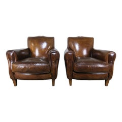 Pair of French Leather Deco Armchairs, circa 1930