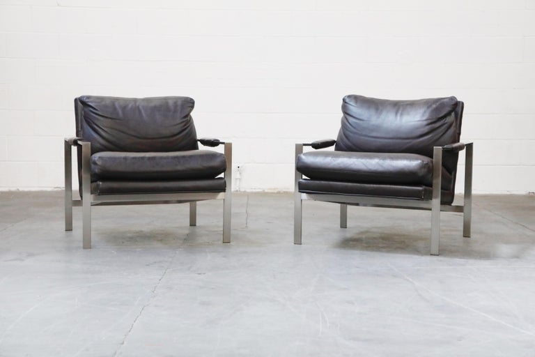 These beautiful stainless steel and full-grain leather lounge armchairs are by Milo Baughman for Thayer Coggin, designed in 1966, and produced by Thayer Coggin in High Point, North Carolina, made in the USA. High quality full-grain leather cushions