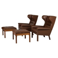 Pair of Leather Lounge Chairs by Hans J. Wegner for AP Stolen