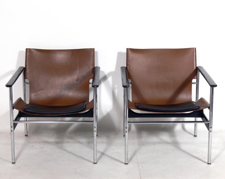Pair of leather sling lounge chairs, designed by Charles Pollock for Knoll, American, circa 1960s. They retain their warm original patina to the original cognac leather sling seats.