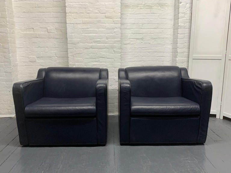 Pair of leather (speed) lounge chairs. The leather is blue. Style of Paul Frankl speed chair.