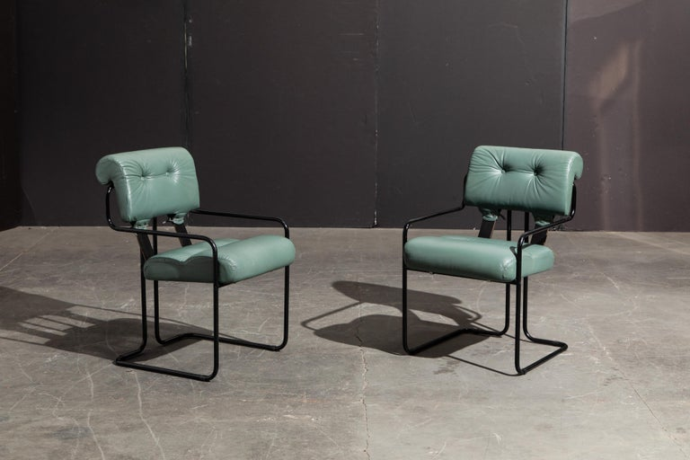 Currently, the most coveted dining chairs by interior designers are the 'Tucroma' chairs by Guido Faleschini for i4 Mariani, and we have this incredible pair of Tucroma armchairs in beautiful leather with rare black frames. The seats and backs