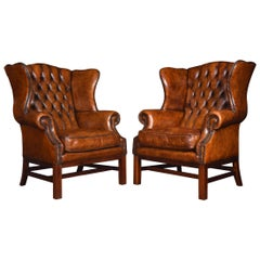 Pair of Leather Upholstered Wingback Armchairs