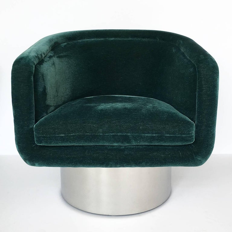 Polished Pair of Leon Rosen Pedestal Swivel Lounge Chairs For Sale