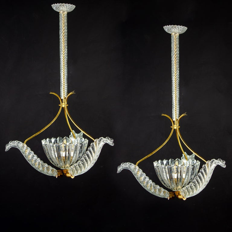 Elegant pair of liberty brass-mounted pendants by Ercole Barovier, 1940s. Each with three precious Murano glass leaves centered by a hand blown elegant cup. One E27 light bulb suitable for international standards.