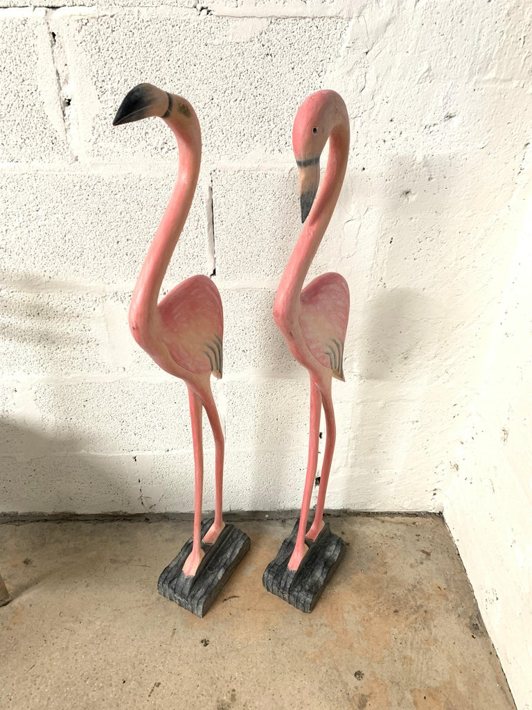 Unique pair of Miami Beach Florida style flamingo sculpture rendered in hand carved and painted wood.