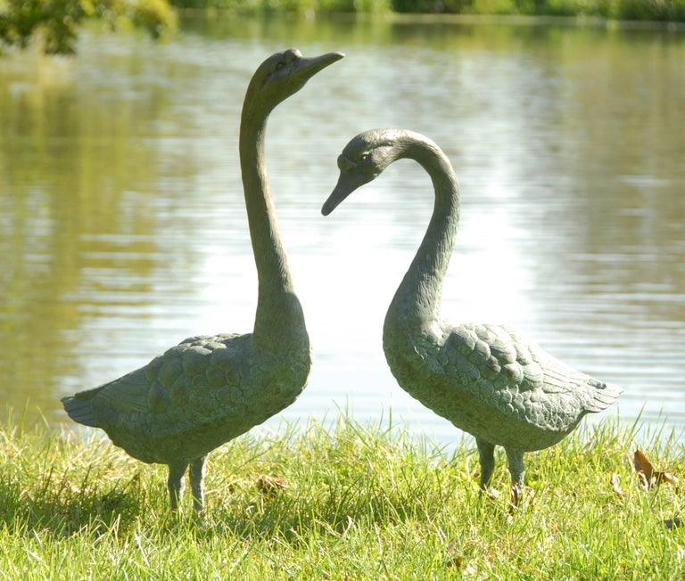 Adorable pair of life-size patinated bronze statues of geese, 20th century freestanding for outdoor or indoor use.