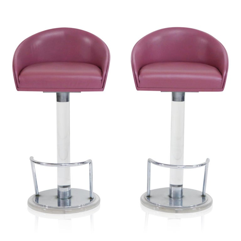 This gorgeous pair of lucite, leather and chrome swiveling barstools by Lion in Frost, circa 1970s, are signed on the lucite post, near the base and are in excellent condition with gorgeous deep Lilac colored leather, which can be described as a