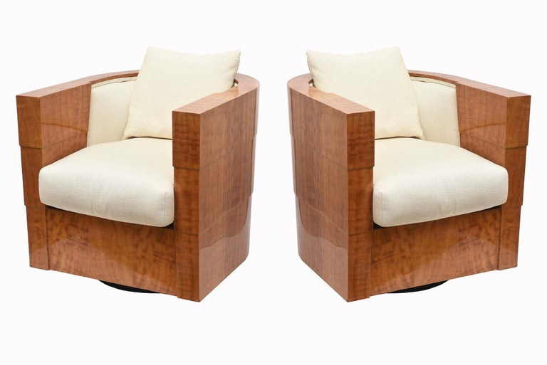 These stunning pair of limited edition swivel Pace club chairs are titled Normandy and were designed by James Rosen of the Rosen Family of the Pace collection. They are made with an exotic veneer finished in high polish lacquer from the South