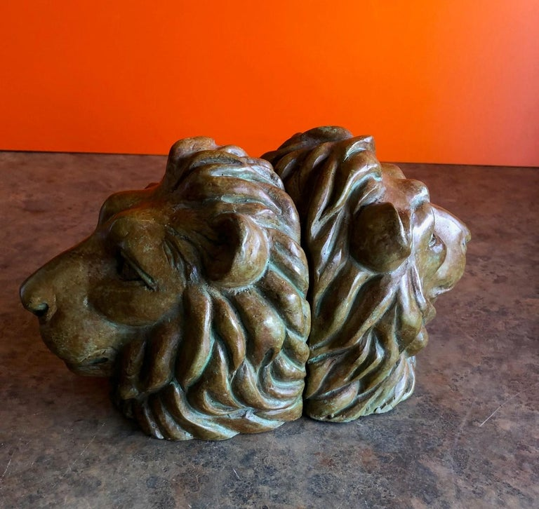 Classic pair of majestic lion head bookends in bronze, circa 1970s.