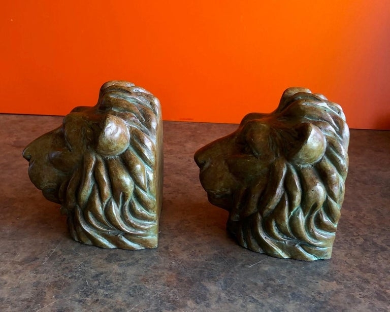 Pair of Lion Head Bookends in Bronze In Good Condition For Sale In San Diego, CA