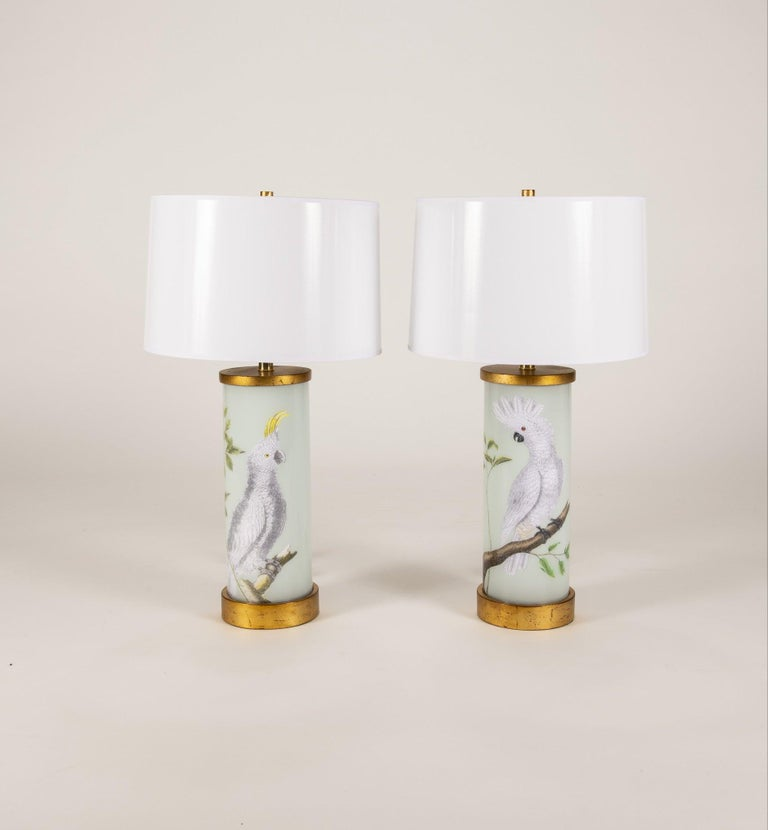 Pair of Liz Marsh cockatoo Eden lamps with white paper shades.  Liz Marsh has a long held fascination with both 17th-18th natural history. Her decoupage creations are original assemblages of her collection of 18th century hand colored engravings.