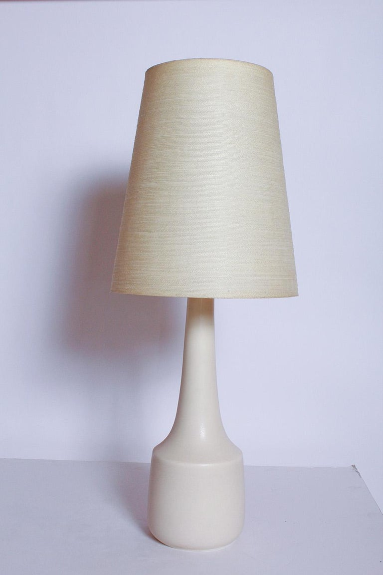 Creamy ceramic table lamps with original fiberglass and bleached jute lampshades by Lotte and Gunnar Bostlund, circa 1970. Please note that this is a matched pair... shades and lamps appear as different colors in the cover photo due to uneven