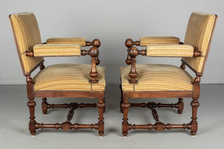 Hand-Crafted Pair of Louis XIV Style French Walnut Fauteuils For Sale