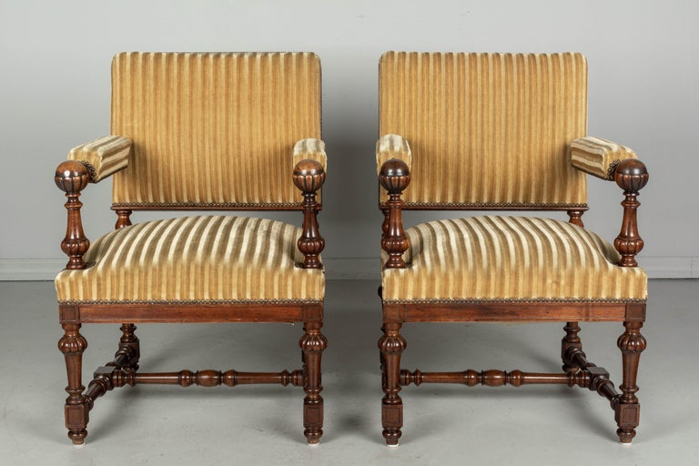 20th Century Pair of Louis XIV Style French Walnut Fauteuils For Sale