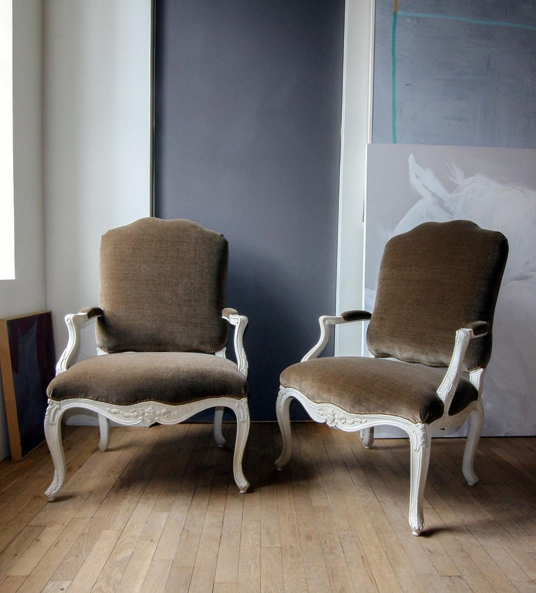 Pair of painted Louis XV Fauteuils a la Reine French, mid-18th century Measures: Height 38 ½ in, width 26 ½ in, depth 20 in, seat height 17 in.   2086.