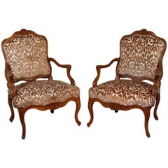 Pair of Louis XV Period Carved Walnut Armchairs of Broad Proportions