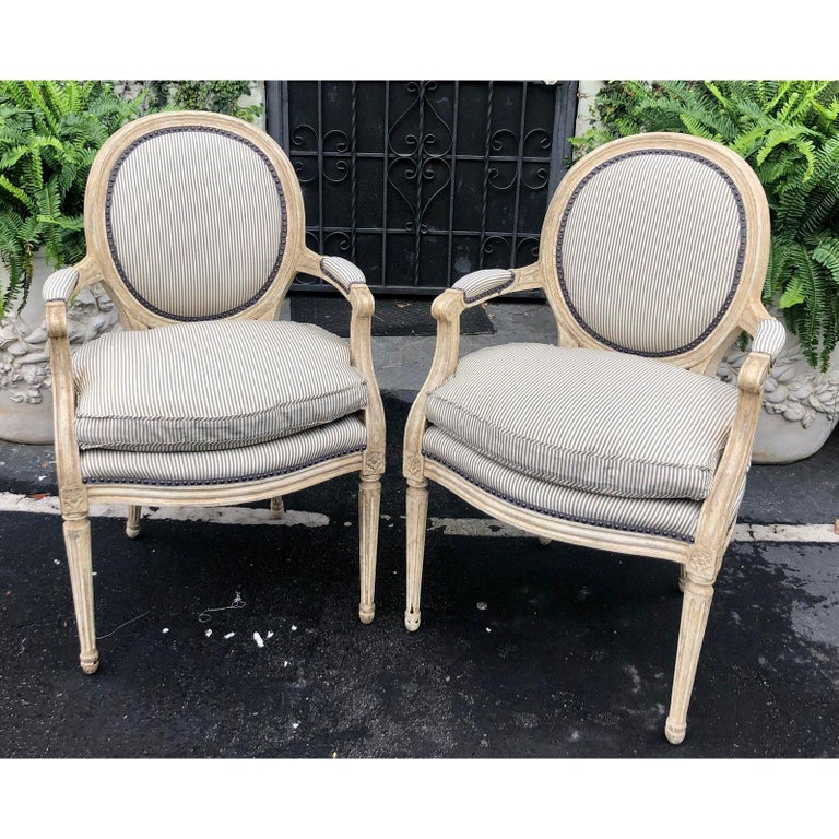 Pair of Louis XV style balloon back armchairs with silk down cushions.