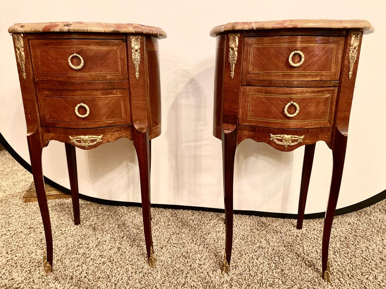 Pair of Louis XV style side / end tables with Breche D'alep original marble tops and bronze mounts. One table with two drawers, the other with front faux drawers to a cupboard, Late 19th century. hSX.