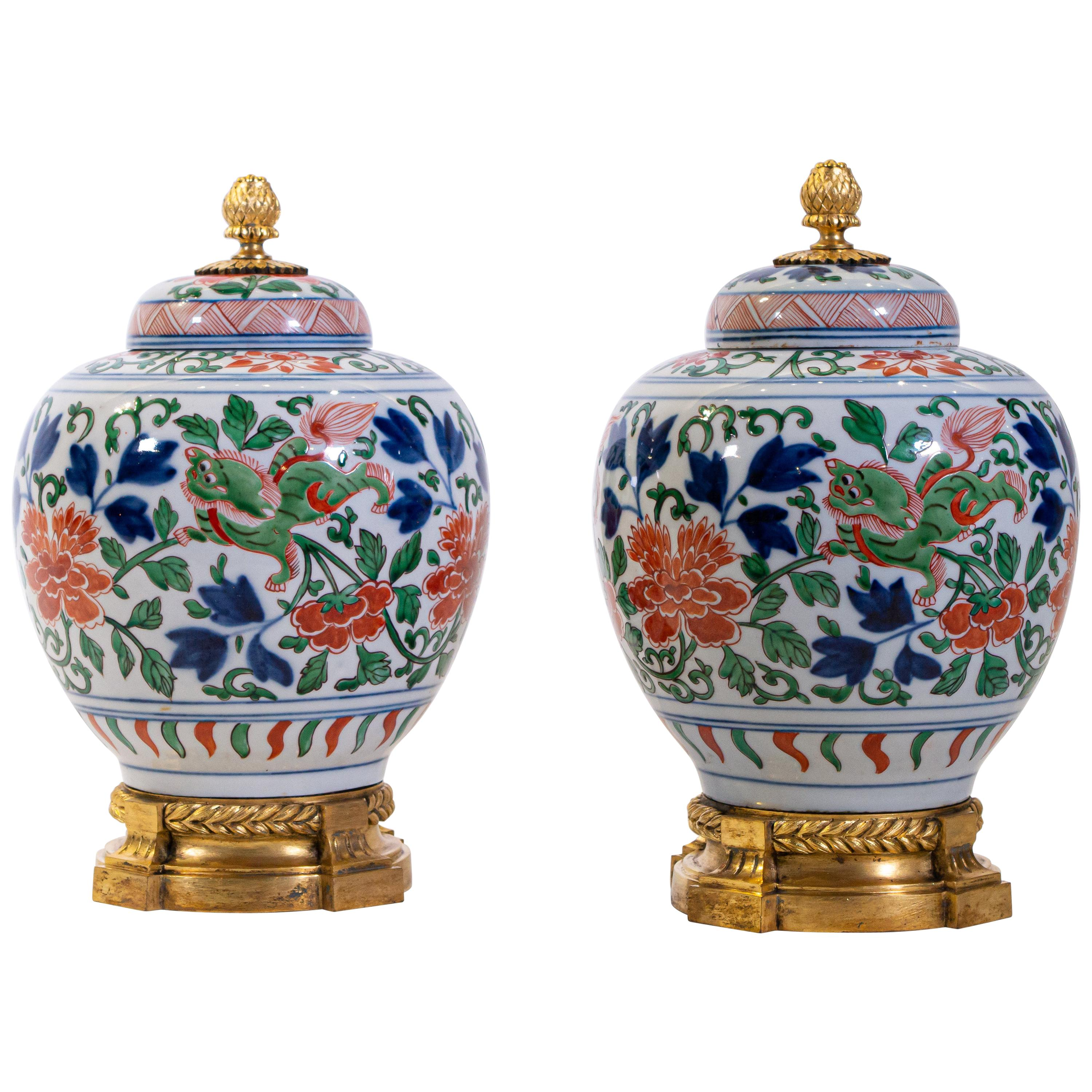 Pair of Louis XVI Dore Bronze Mounted Chinese Porcelain Wucai Covered Urns