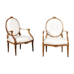 Pair of Louis XVI Style 19th Century Oval Back Fauteuils with Floral Motifs