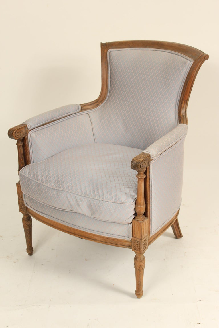 Pair of Louis XVI style carved beech wood bergeres, late 20th century.