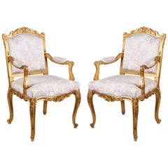 Pair of Louis XVI Style Carved Giltwood Armchairs, by Mellier & Co