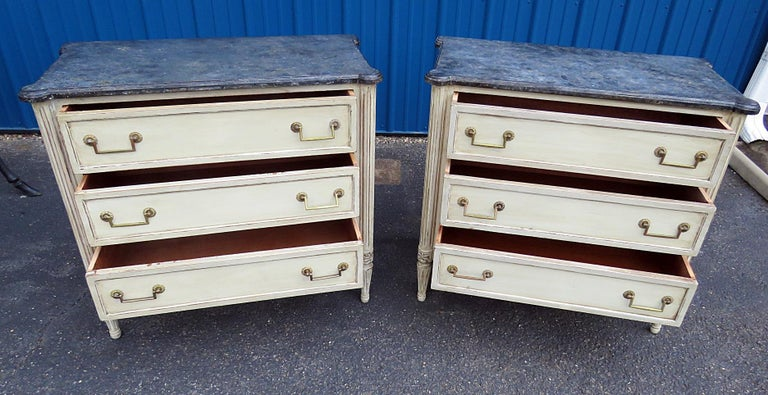 Pair of Louis XVI style faux marble top 3-drawer commodes, with a distressed finish.