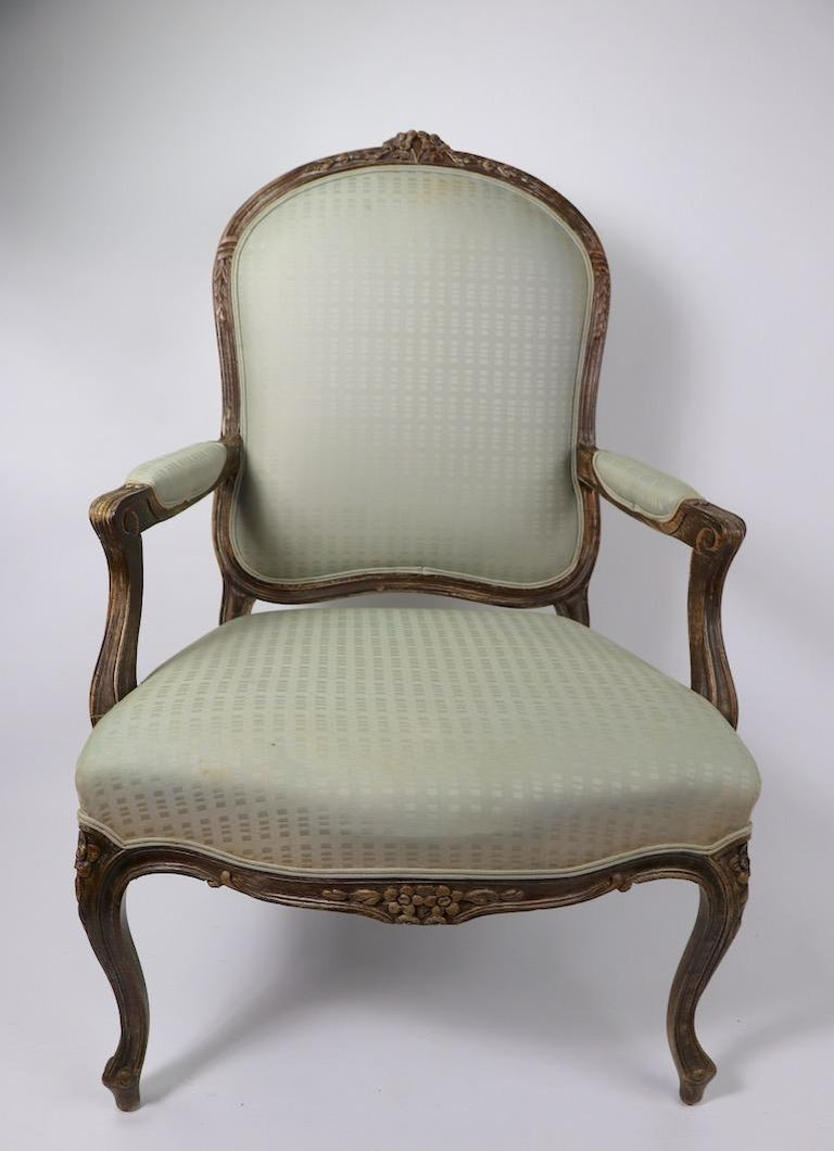 Pair of Louis XVI style fauteuils armchairs, both are structurally sound and sturdy, both will need to be reupholstered. 20th century examples - offered and priced individually, but we would love to see them stay together. Measures: Seat H 17 inches