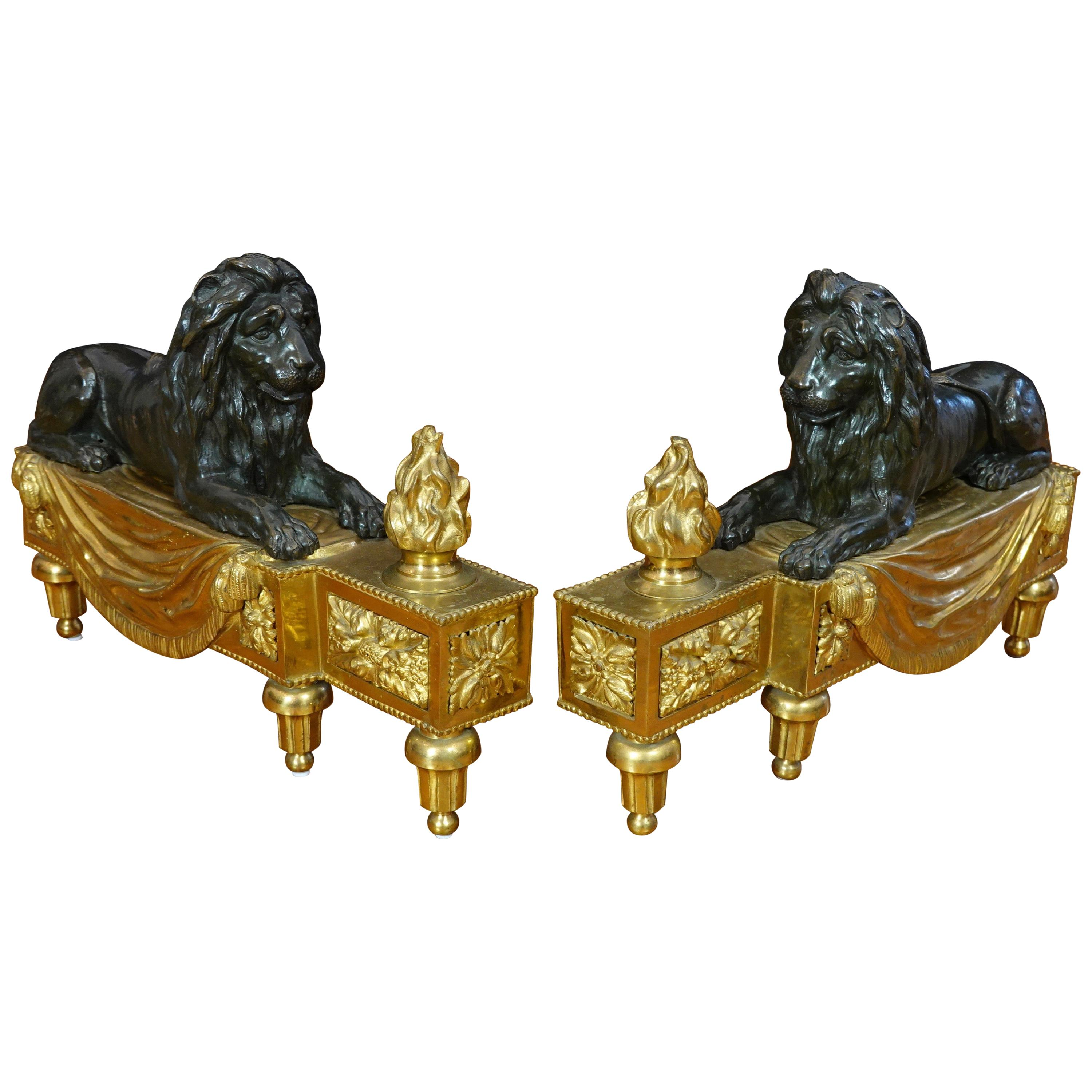 Pair of Louis XVI Style Gilt and Patinated Bronze Lion Chenets or Andirons