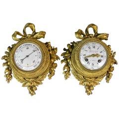 Pair of Louis XVI Style Gilt Bronze Wall Clocks and Barometer